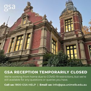 Photo of the 1888 Building, an ornate Victorian brick building, lit up at night. Text reads 'GSA Reception temporarily closed'.