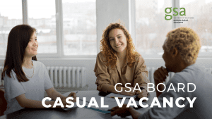 Three young people sit in conversation at a table. Overlaid text reads GSA Board Casual Vacancy.
